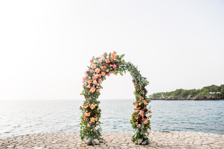Floral Wedding Arch at Rockhouse Hotel in Negril Jamaica of Shannon Skloss