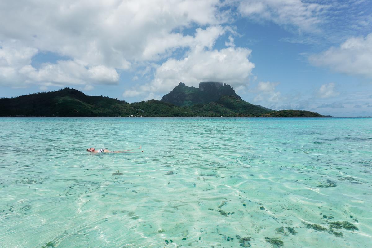 Photographer Shannon Skloss floating in Bora Bora